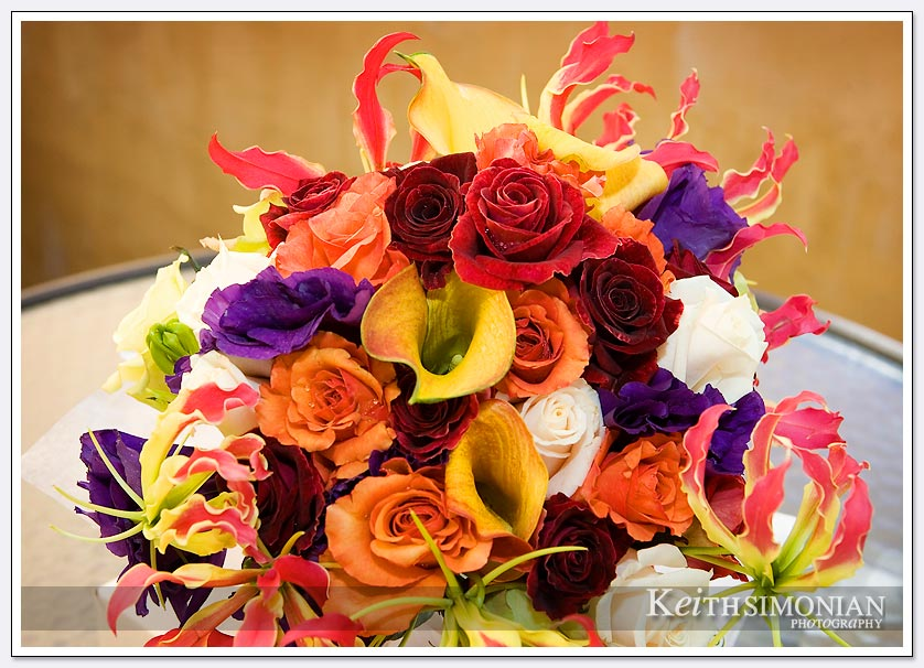 Red, blue, white and orange flowers make up this bouquet