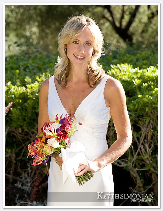 The golden California sunlight illuminates this Napa Valley bridal portrait at the Auberge Du Soleil
