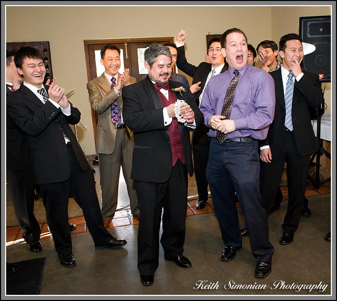 Hui and Eugene Wente wedding Garter toss