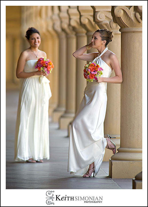 The Brides pose outside the church by the columns