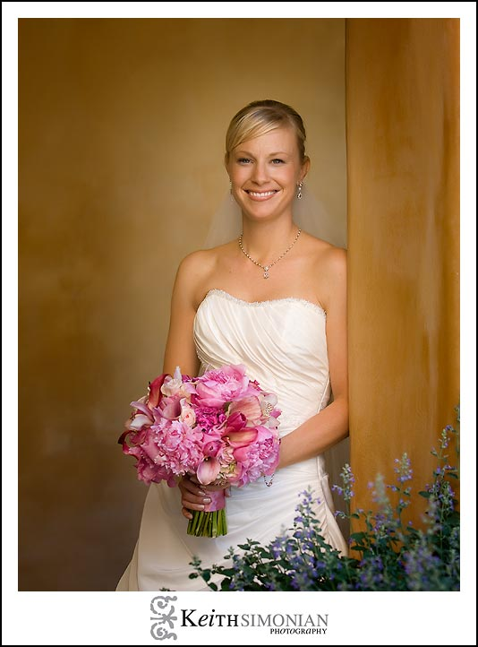 The architecture of the Nicholson Ranch Winery is used for a bridal portrait.