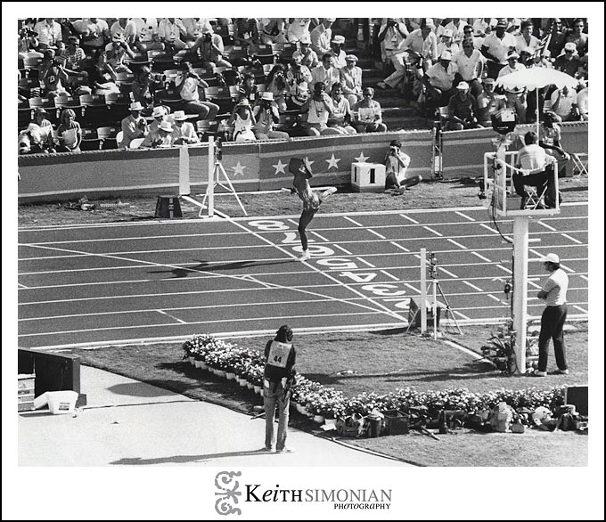 Anchoring the 4 x 100 meter relay, Carl Lewis wins his 4th gold medal of the 1984 Summer games