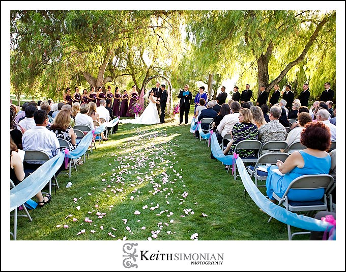 Pepper trees provide shade during wedding ceremony at Discovery Bay