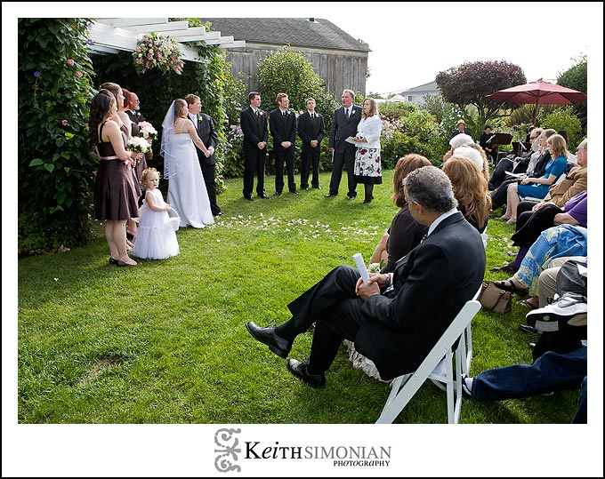 Wedding party and guests during wedding ceremony at San Benito House in Half Moon Bay