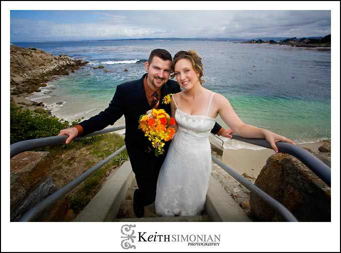 The blue Pacific ocean behind the bride and groom at Lover's Point