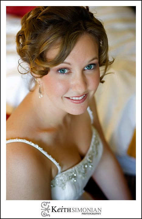 Bride's blue eyes sparkle in this portrait