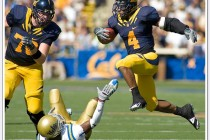 Cal running back Jahvid Best jumps over a UCLA player on his way to a 34 yards touchdown run.