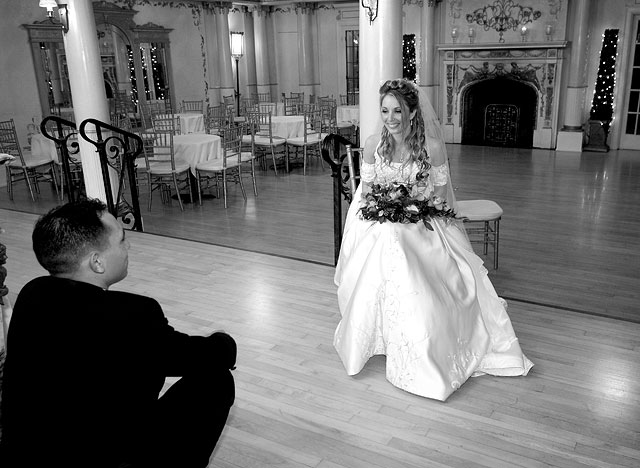 The bride and groom share a private moment before the reception starts - Black & White photo