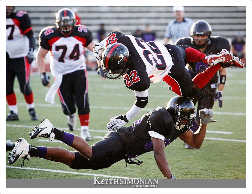 Outlaws RB #22 Lontavious Johnson is sent flying during the team