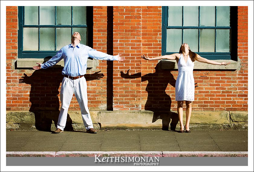 Cassie and Ben in soak up some rays in front of one of many old buildings at Mare Island.