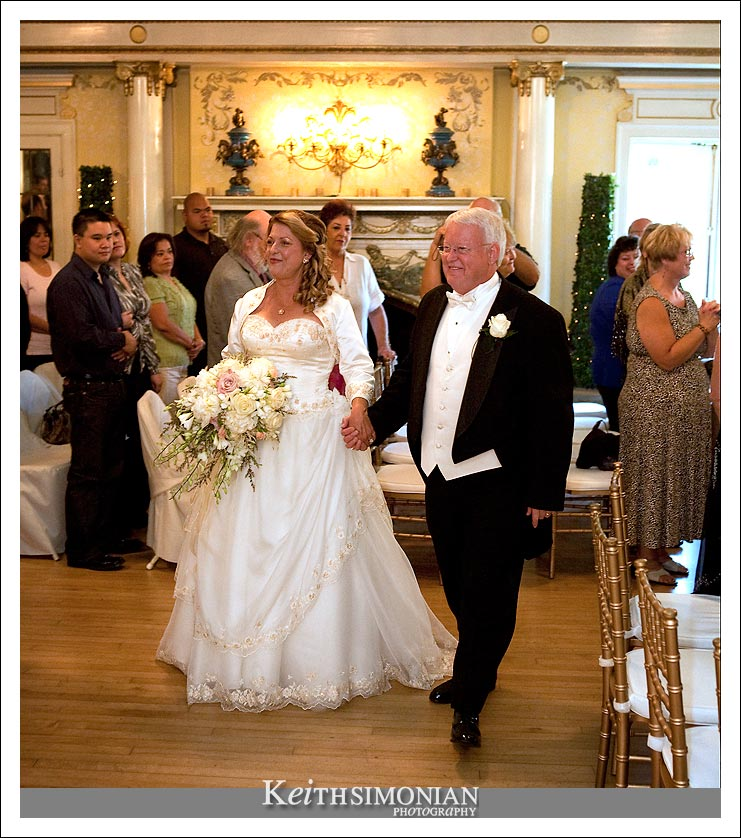 Gail and Rodney walk down the aisle as husband and wife.