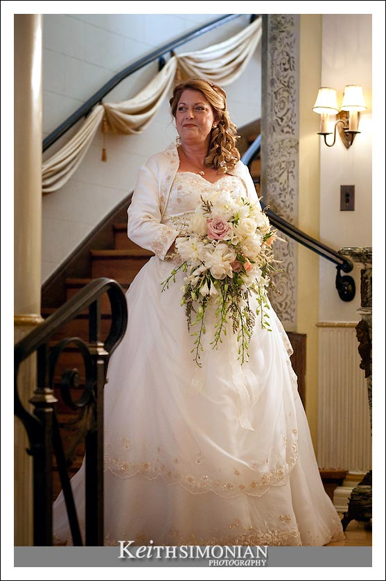 Gail walks down the elegant staircase to the ceremony.