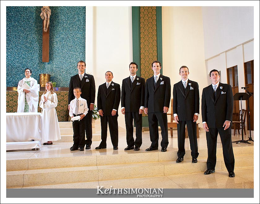 The groomsmen and best man wait for the bride