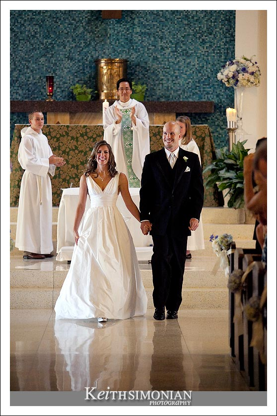 Casie and Ben walk down the isle as husband and wife