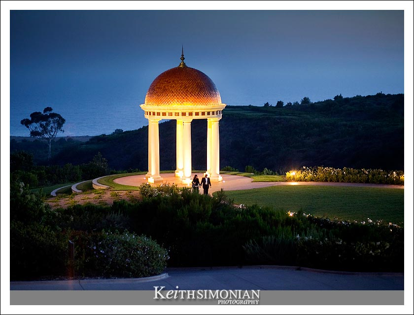 Night view of the rotunda and the Pacific Ocean in the background