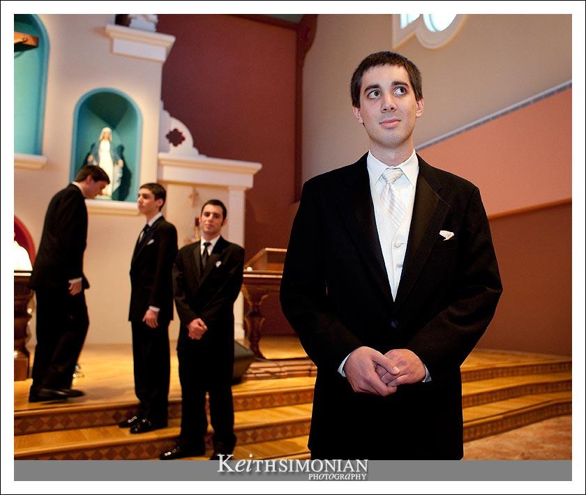 Nathan waits for Bridgett to be escorted up the aisle by her mother and father