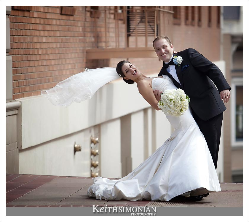 Groom dipping bride on the streets of San Francisco