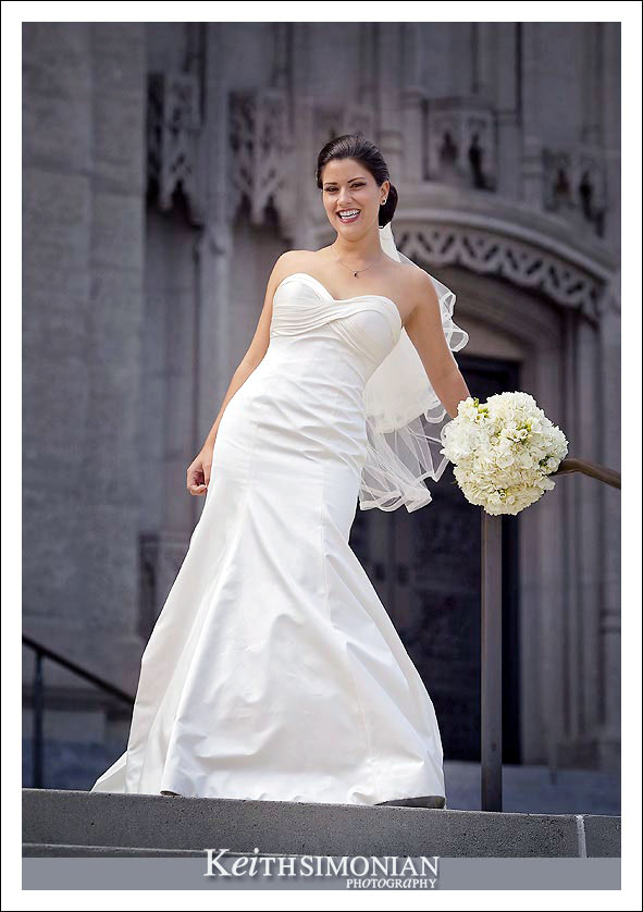 The bride on the stairs in front of Grace Cathedral Episcopal church
