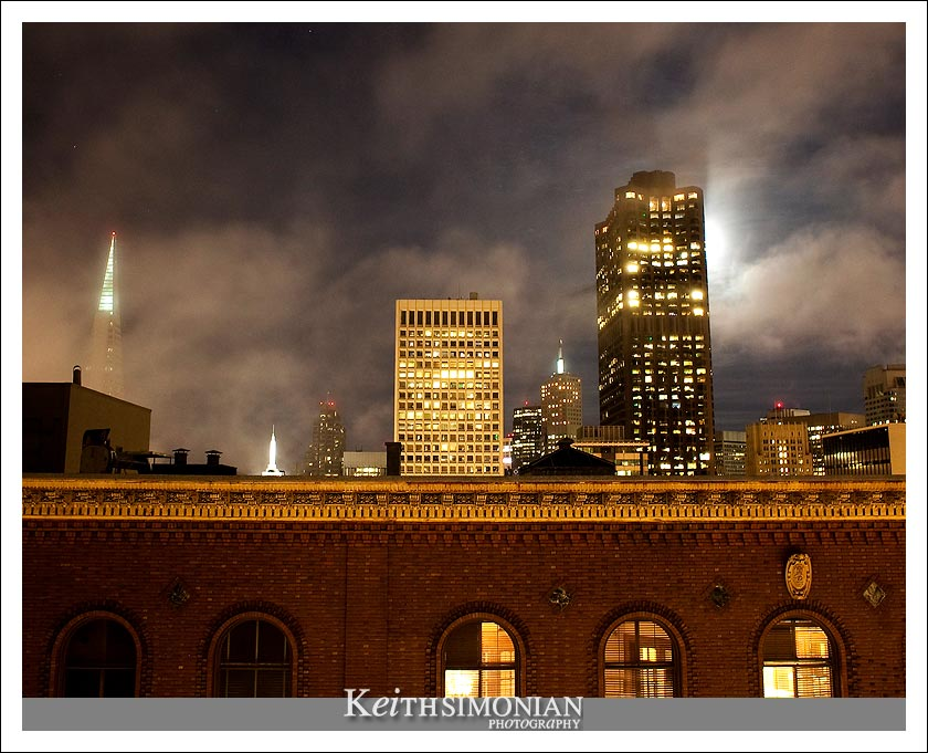 The fog lifts enough so that guests can view the Transamerica pyramid and Bank of America building