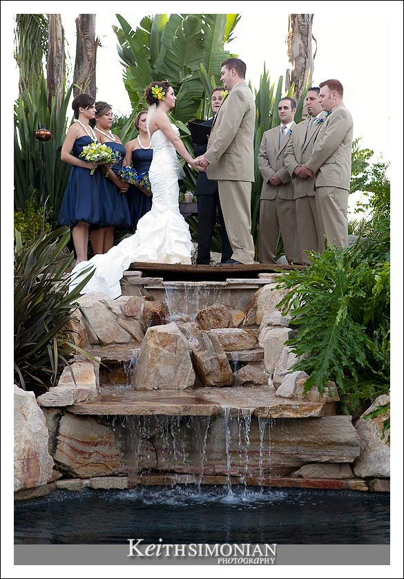 The wedding ceremony takes place over the waterfall
