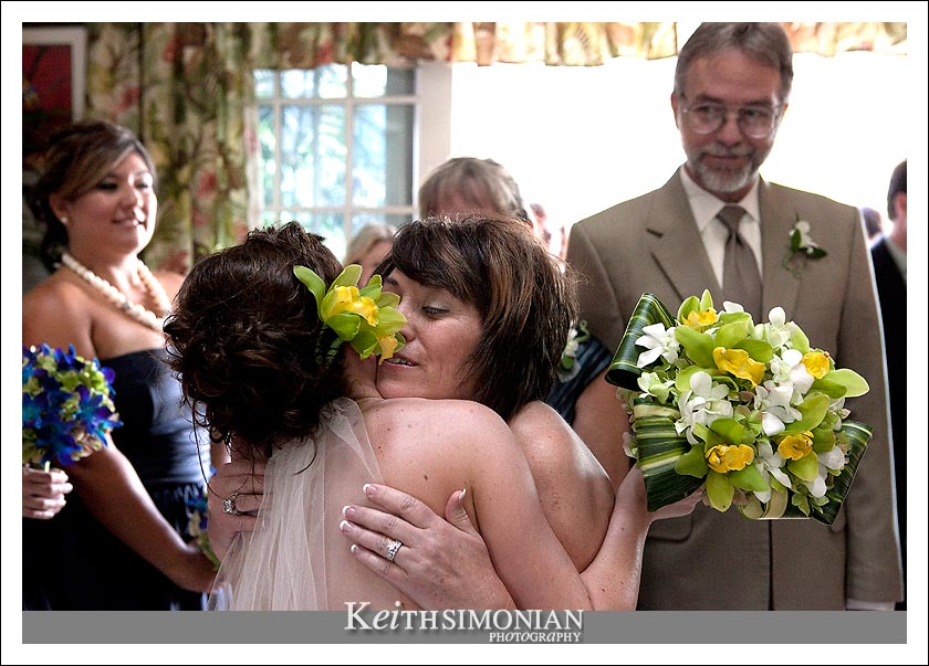 Kirsten's mom gives her a hug after the wedding ceremony