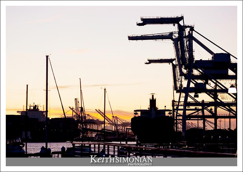 Sunset photo of the giant cranes that unload ships at the Port of Oakland