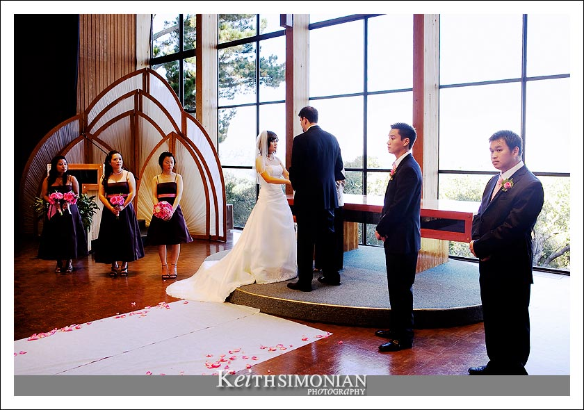 The wedding ceremony took place in front of the spectacular glass wall