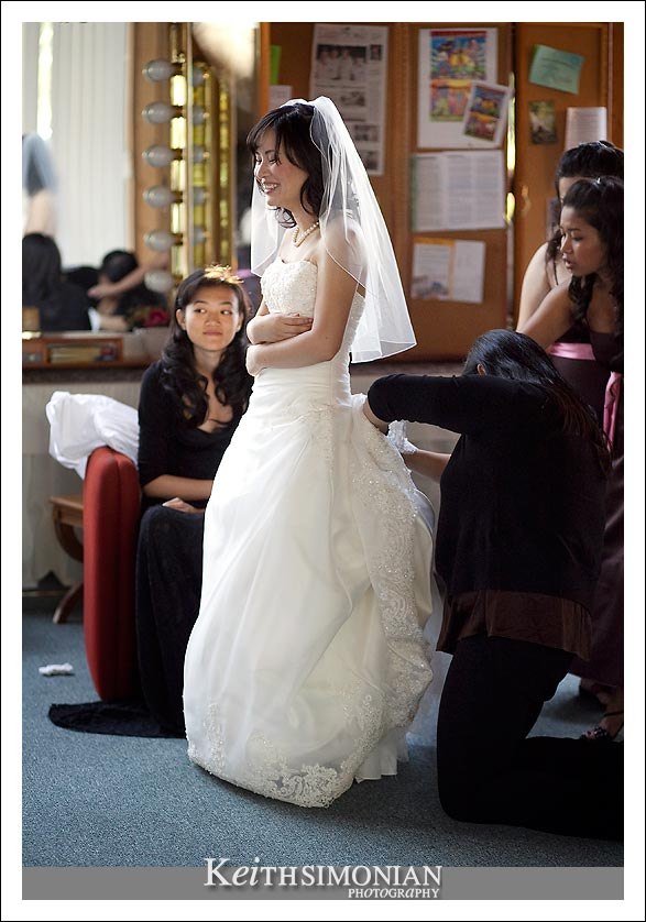 Having your wedding dress bustled isn't as easy at it might seem