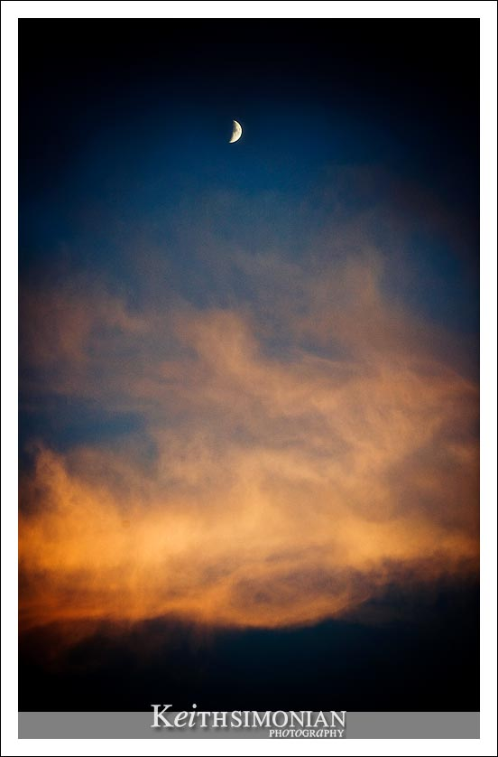 Crescent moon rise over late October sky photo