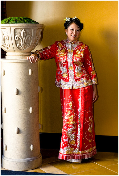 Bride wearing traditional red Chinese wedding dress at the Cypress Hotel in Cupertino