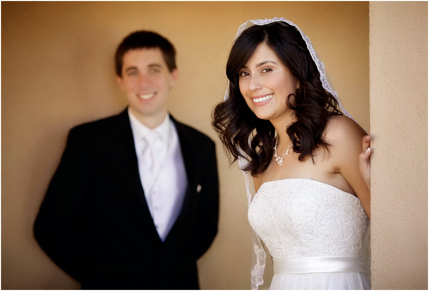 Selective focus with bride and groom at the St Mary's church in Vacaville