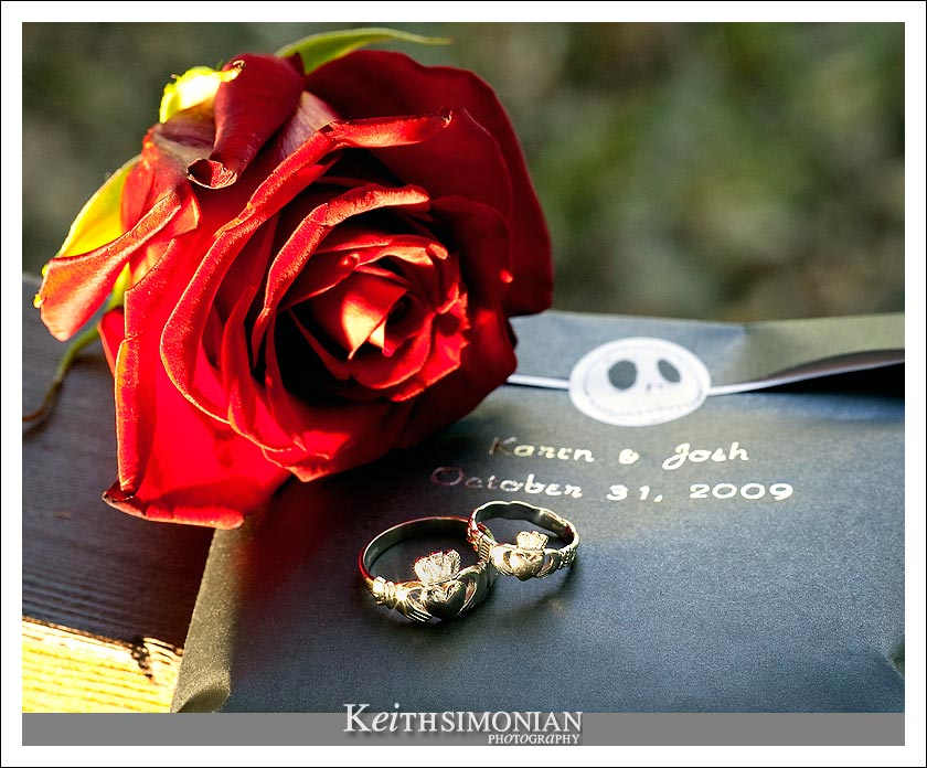 The bride and groom's rings and wedding favors photo.