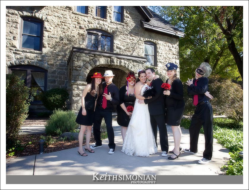 The wedding party in front of the stately 17 room, three story, neo-Romanesque mansion at Elliston Vineyards.
