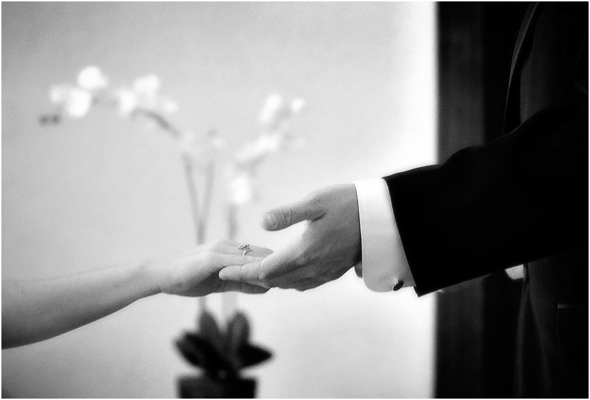 Bride and groom hold hands during first meeting on wedding day