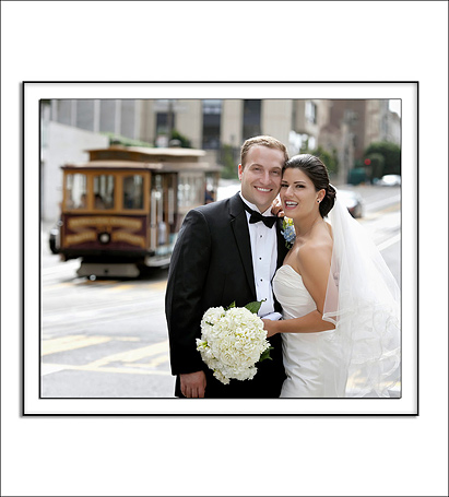 Bride and Groom with cable car behind them