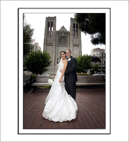 Bride and Groom pose in Huntington Park with Grace Catheral Church in the background