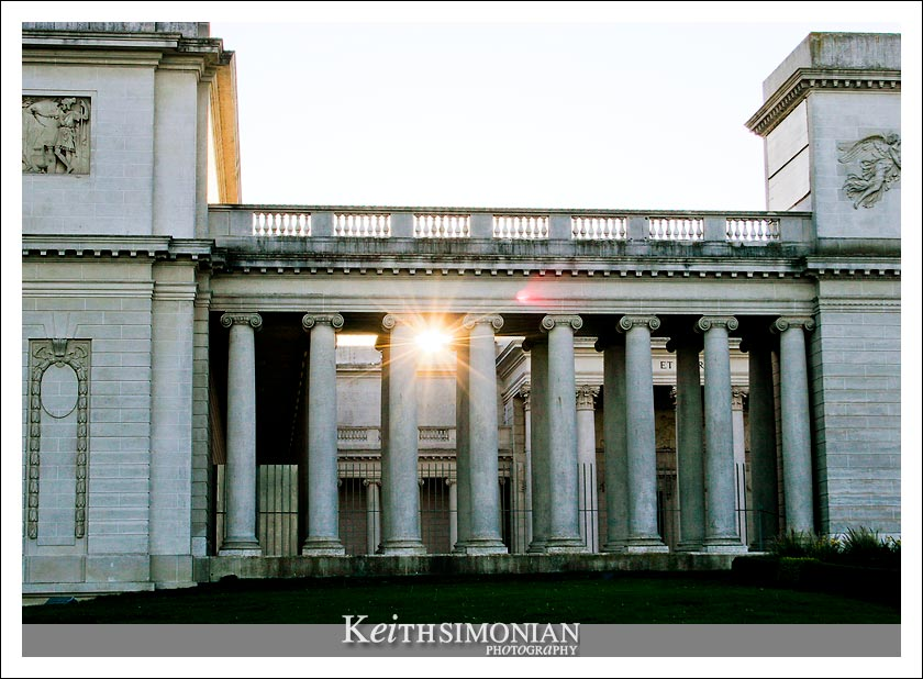 The last rays of sunlight pass through the columns of the palace which is a three-quarters scale replica of the Palais de la Légion d'Honneur in Paris