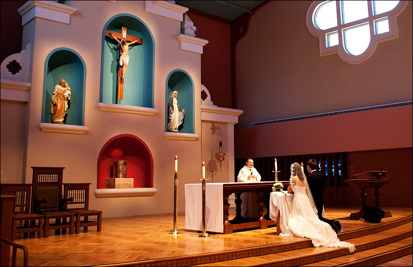 Bride and Groom at alter of St Mary's church - Vacaville, CA