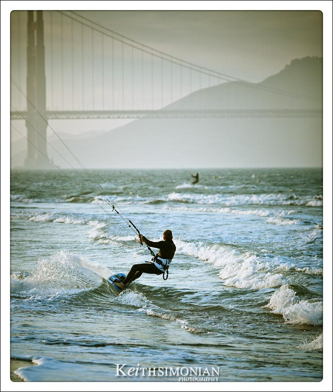 Riding the waves with the Golden Gate Bridge in the background