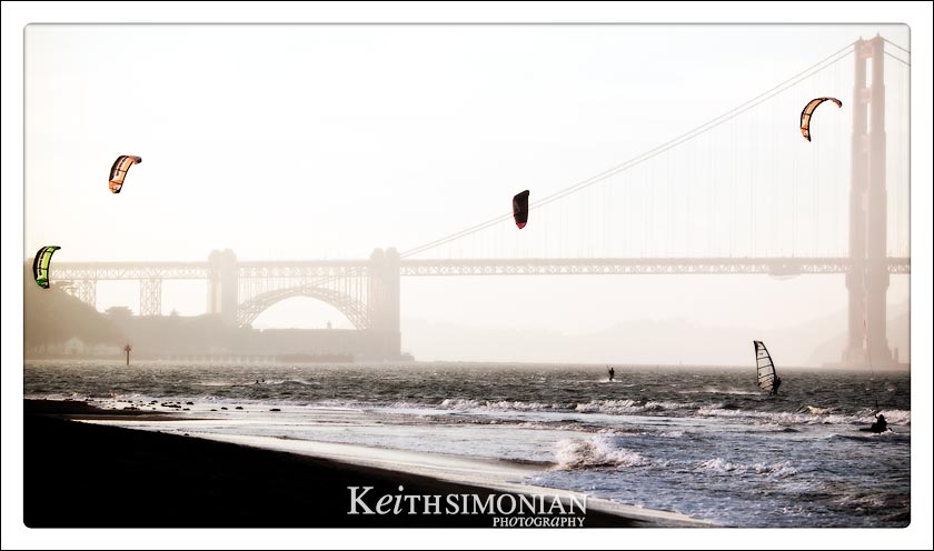 Kite surfing and Wind surfers with Golden Gate Bridge in background