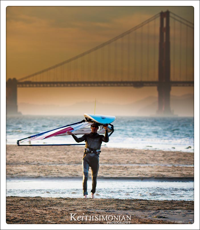 Wind Surfer calling it a day with a sunset over the Golden Gate Bridge