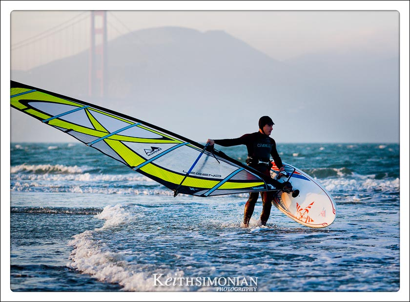 Wind surfer heading out into the San Francisco Bay from Chrissy field