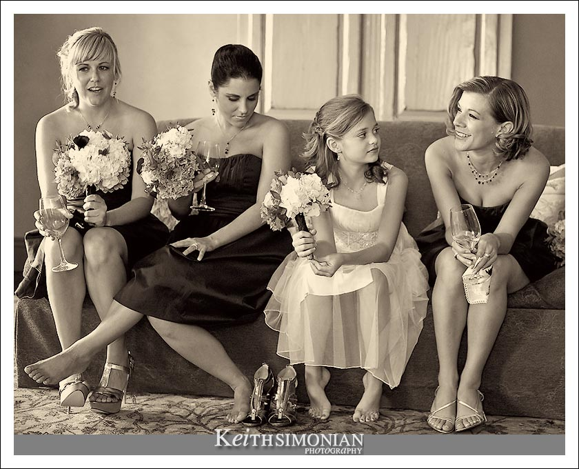 Bridesmaids and flower girl relax before the ceremony