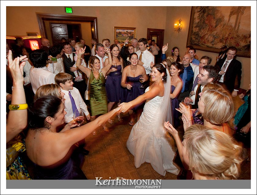 bridesmaid and bride celebrtate the day by dancing the night away