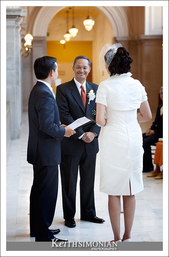 Groom smiling during San Francisco city hall wedding