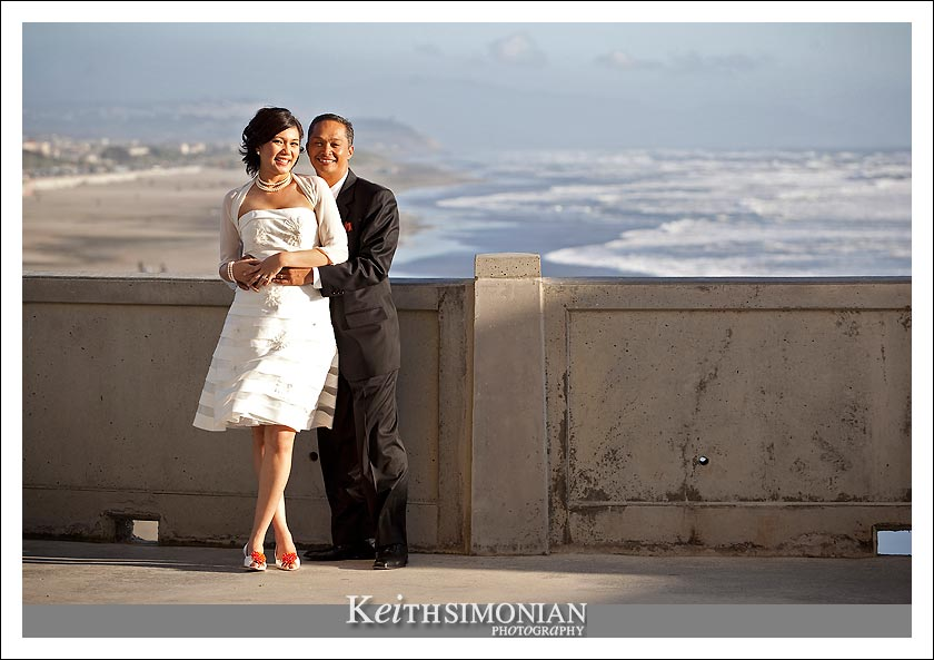 View of Pacific Ocean and bride and groom