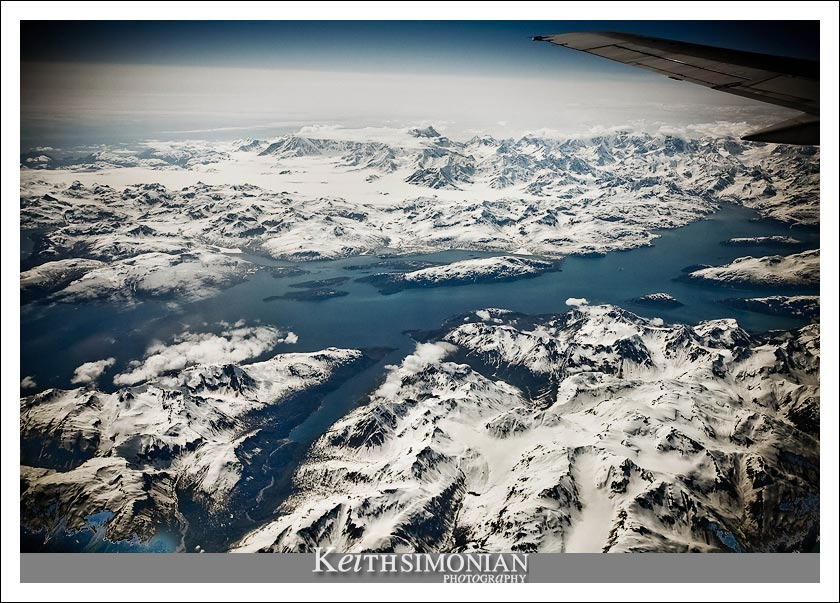 Alaskan mountains seen from an altitude of 39,000 feet from the window of a Alaska Airline Boeing 737-800