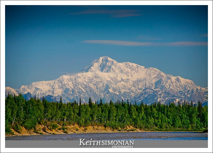 """River view of  Mt. McKinley which is also known by its Athabascan name Denali meaning """"The Great One"""""""