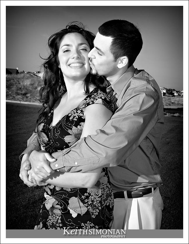 Black and white Engagement photo on golf course