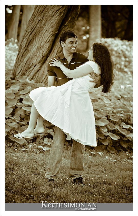 Groom carrying bride to be in Sutro Heights Park San Francisco photo